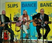 Slips Dance Band fra Esbjerg spiller danske og udenlandske hits, tilbage fra 60'erne. Der er både kvindelig og mandlig forsanger til at løfte stemningen!